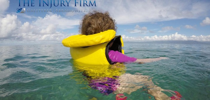 Little child (girl age 3) floating with a life jacket alone in the ocean. Travel insurance concept Real people copy space.