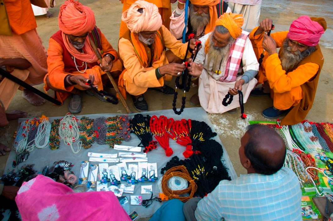 a group of sadhus buying garlands and miscellaneous artefacts