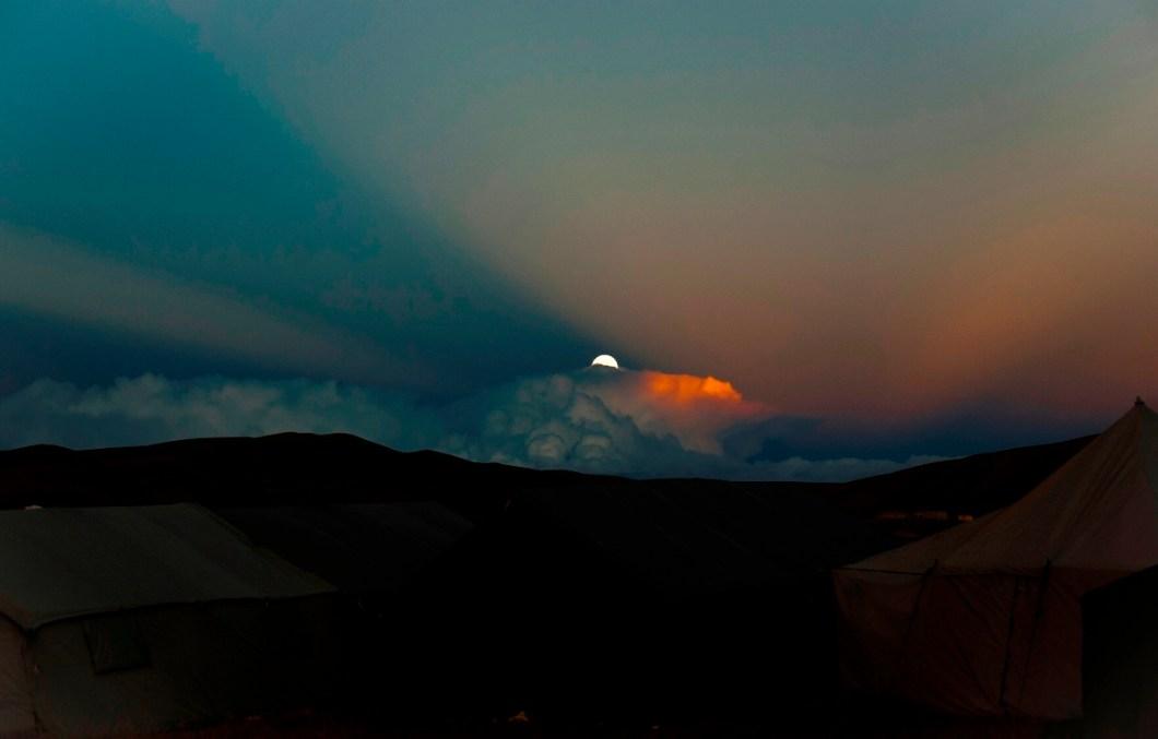 serenade of setting sun and the rising of full moon at Mansarovar banks