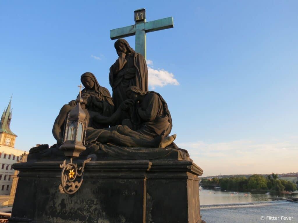 Maria Statue on Charles Bridge with the Vltava River on the background Prague Praag Moldau