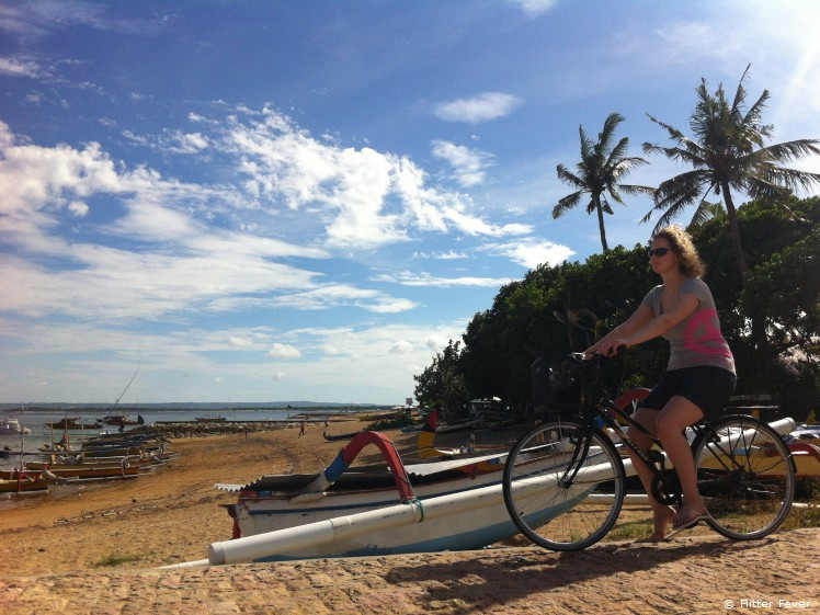 Rent a bike and ride along the beach