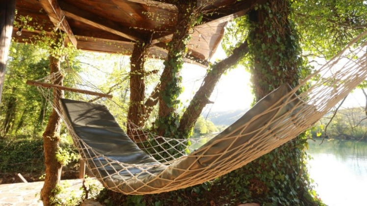 Relax in this hammock at Treehouse Bihac in Racic, Bosnia-Herzegovina