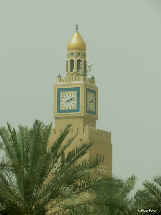 Arab designed tower of mosque with clock in Kuwait