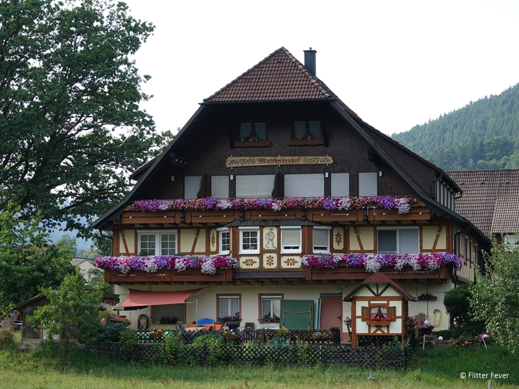 Traditional authentic house in Baiersbronn, Black Forest with flower window boxes