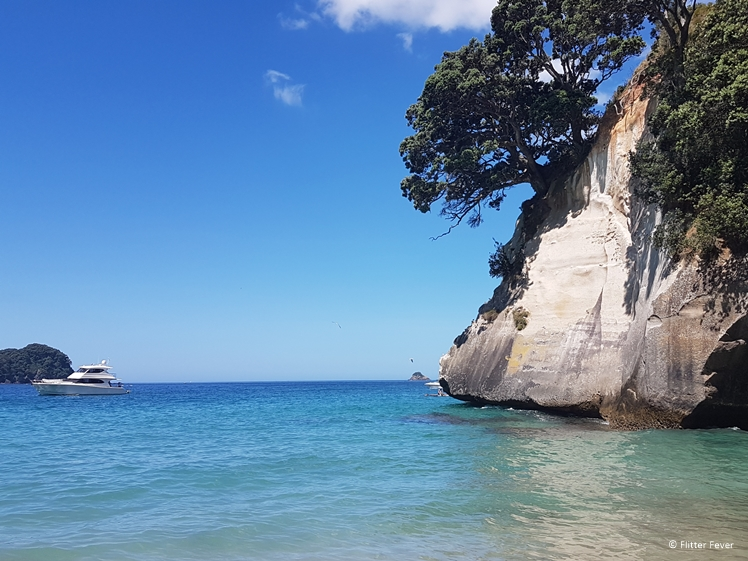 Cathedral Cove sea water, shore and boat