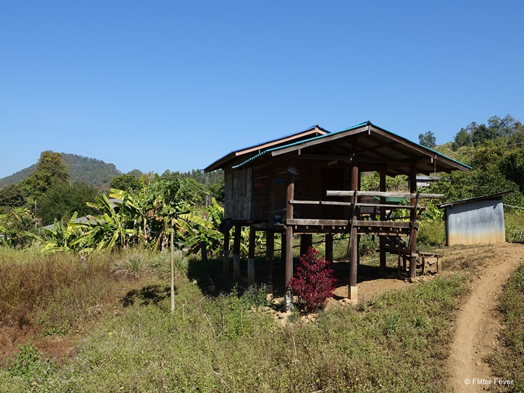 Wooden house on poles of Karen people living near Lod Cave