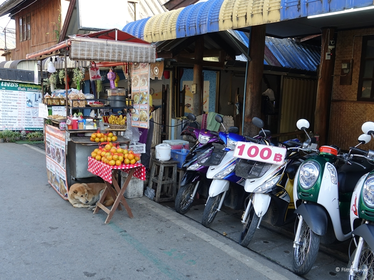 Scooters for rent and food stall in Pai Thailand