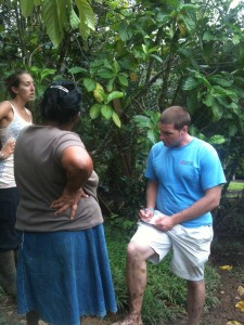 Dr. Ben consulting with a peace corps volunteer about issues in the community