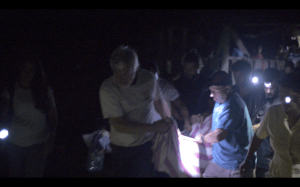 The Floating Doctors team working together to evacuate the mother.
