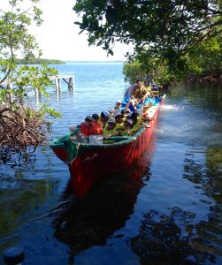 Departing for clinic in our giant canoe