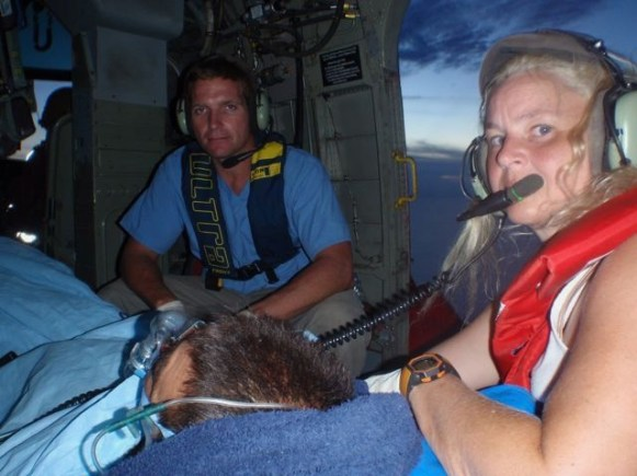 Crossing the mountains in Honduras in a rescue helicopter transporting a family burned in a house fire