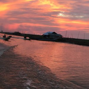 Sunset on a Private Floating Village Tour