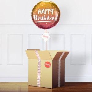 Goldener Geburtstagsballon im Karton