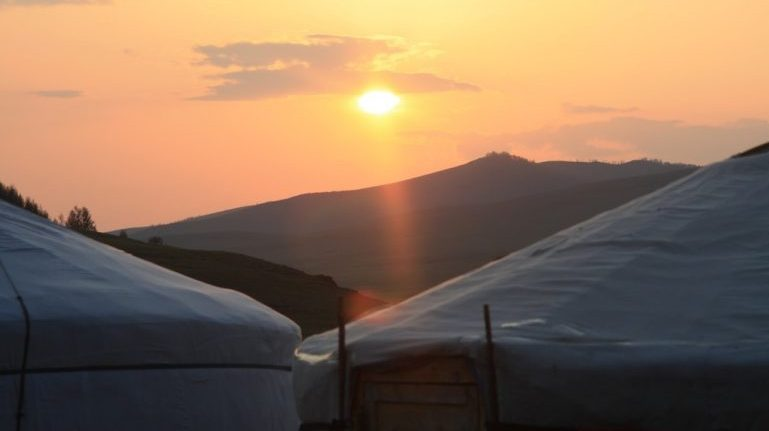 Sunset over gers on the Mongolian steppe