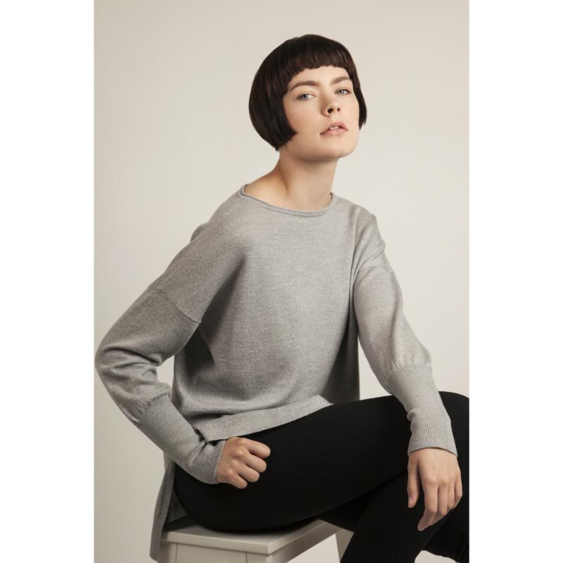 """Model wears merino wool jumper ('Eloise"""") in grey"""