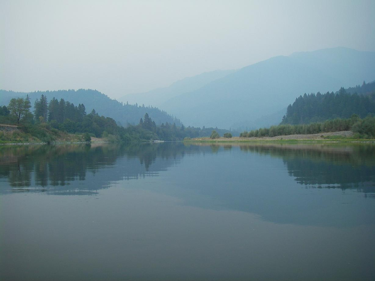 Looking upstream from the tailout - a smokey sky and lots of wide open flat water.  I will prbably return here to better learn the water that lies behind where I'm standing.
