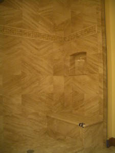 Marble shower niche with arched top