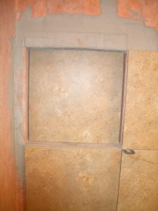 Placing the back wall tile in the niche