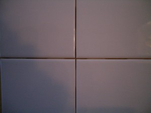 Close-up of lugged tiles grout line