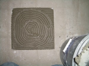 Bullseye combed into the back of the tile