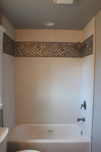 porcelain shower with glass and metal mosaics