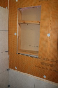 Installing blocking on the top and bottom of the niche for support