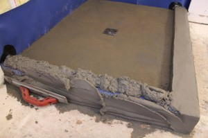 Packing and embedding mud into lath