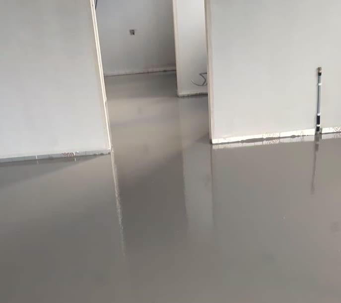 Ultra-thin liquid screed freshly poured