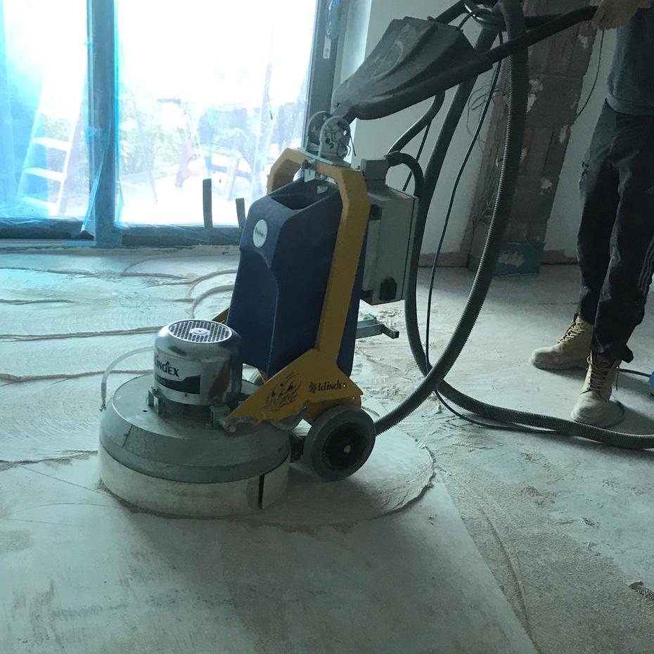 Laitance removal machine on screeded floor