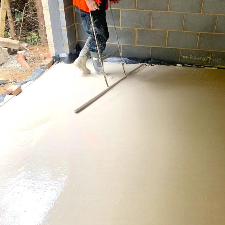 Liquid Anhydrite screed floor being smoothed by professional