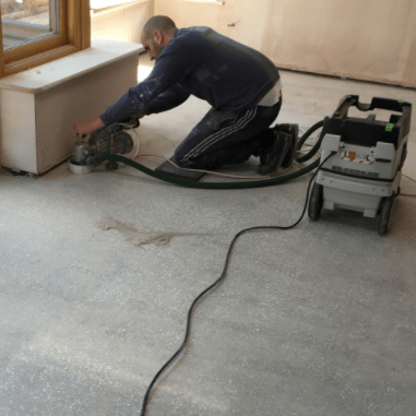 Screed floor being polished by a professional