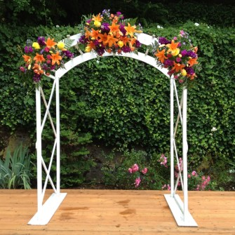traditional style floral on a white arbor at Laurelhurst Club