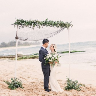 Beach wedding, lots of greenery