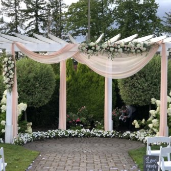 The grand arbor at Aerie At Eagle Landing with blush fabric