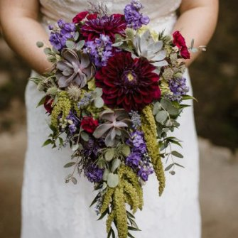 Purple & green dahlias & succulent cascasding bouquet