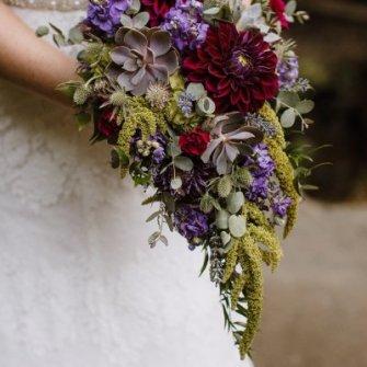 Purple & green dahlias & succulent cascasding bouquet