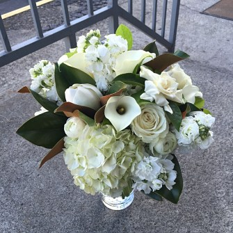 Mostly white bridal bouquet with magnolia blooms & foliage
