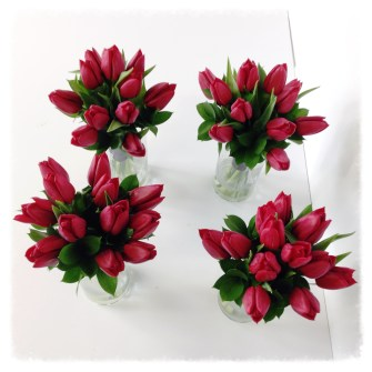 Bridesmaids bouquets of all red tulips