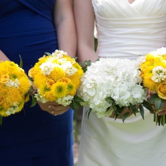 white hydrangea bouquet with italian ruscus and yellow bridesmaids mixed flower bouquets