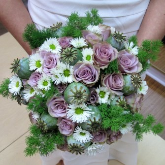 purple roses, mixed flowers, poppy pods bridal bouquet