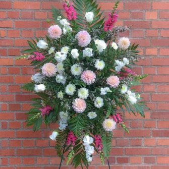 Shades of pinks & white standing spray with seasonal flowers