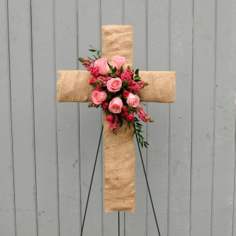 Burlap cross with pink floral accent