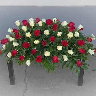 Casket spray of white & red roses