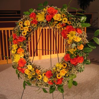 Large memorial standing wreath of fall / autumn flowers