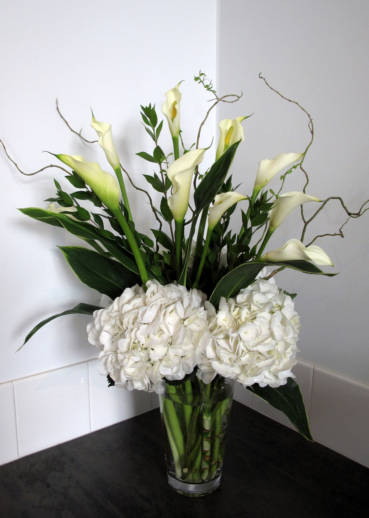 Flower arrangements gallery floral sunshine arrangement of white calla lilies and white hydrangeas stylized with curly willow dhlflorist Images