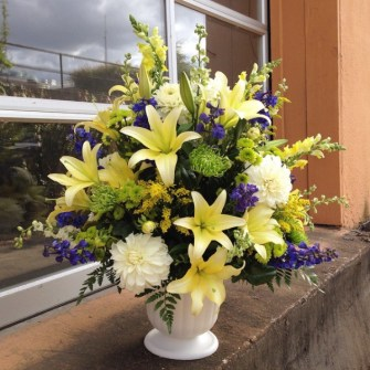 Neutral colors floral arrangement in an urn