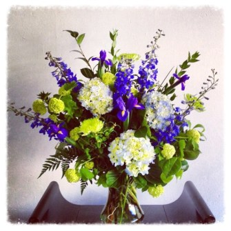 large purple, blue and green vase arrangement