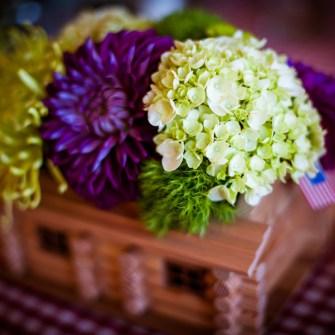 Custom wedding centerpiece in/atop a wooden cabin