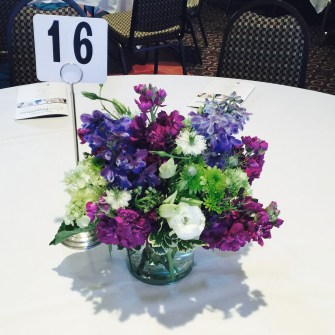 mixed summer centerpieces (in their company colors) for a corporate dinner event