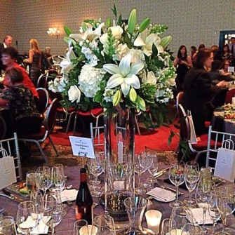 elevated white & green flowers for an auction dinner table
